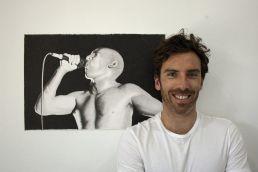 Artist Dean Spinks with his portrait of Maynard James Keenan