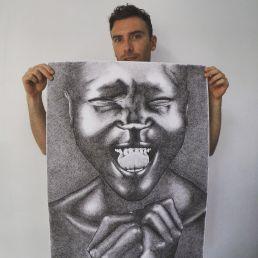 Artist Dean Spinks holding Alek Wek portrait