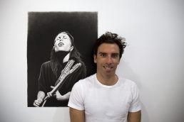 Artist Dean Spinks with Tash Sultana portrait