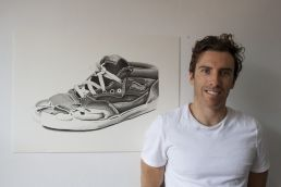 Artist Dean Spinks with his Vans shoe drawing